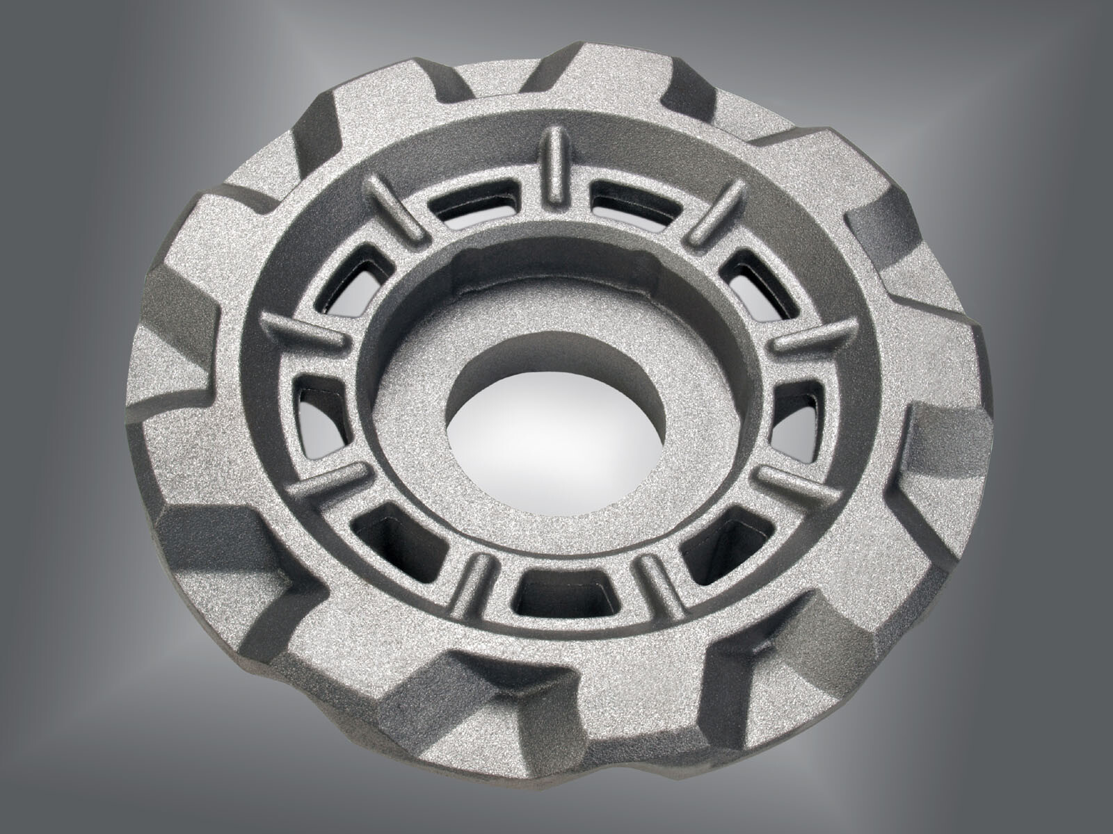 traction wheel for drivetrain application of a handling robot made of ductile cast iron with 150 kg part weight.