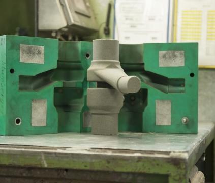 Automatisierte Kernherstellung im Cold-Box-Verfahren für Armaturen aus Gusseisen